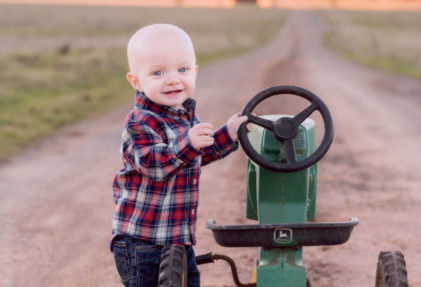 Little John Hardin with his tractor