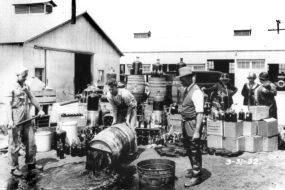 Men smashing barrels of booze during prohibition