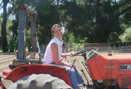 Laura Cooper on the tractor